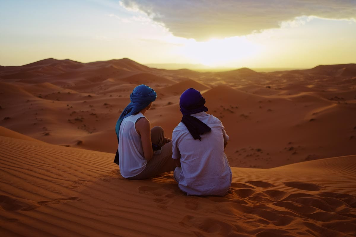two-men-sitting-in-the-desert