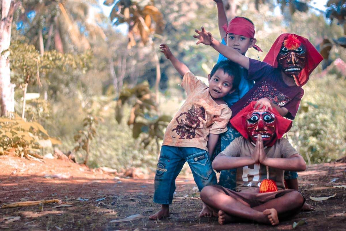 what-is-indonesia-famous-for-children-with-masks-making-signs