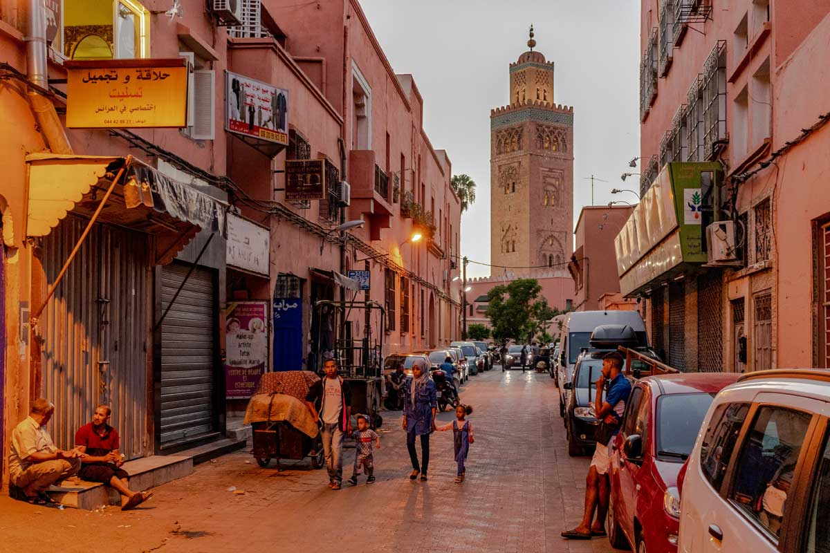 what-is-marrakech-famous-for-an-alley-with-a-tall-minaret-in-the-back