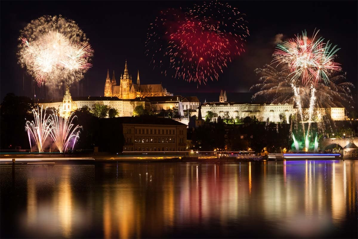 what-prague-is-known-for-charles-bridge-at-night-with-fireworks-in-the-sky