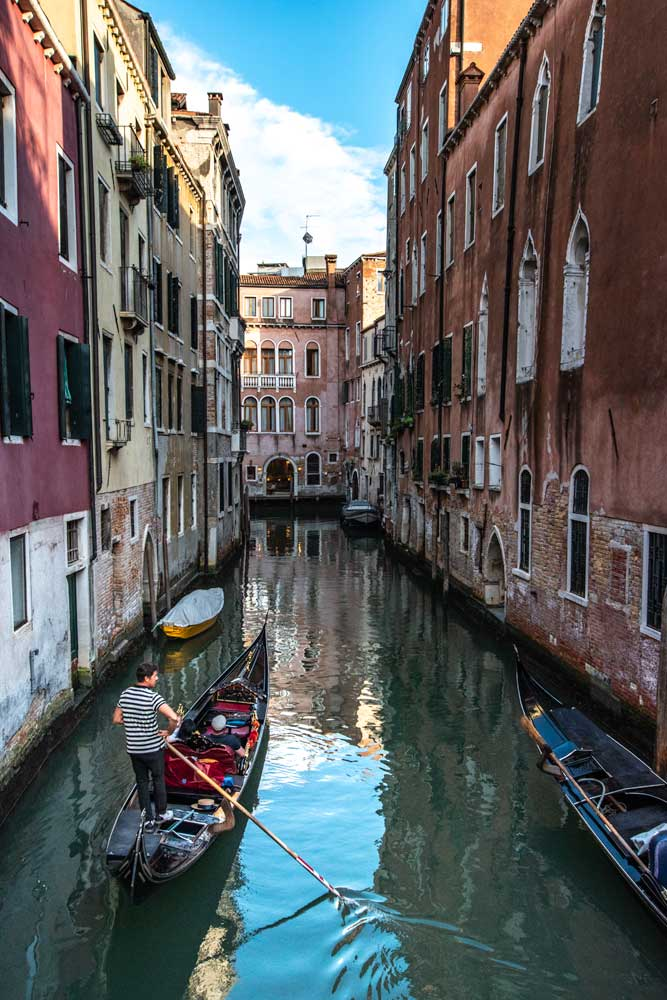 venice-gondola-surrounded-by-colorful-buildings